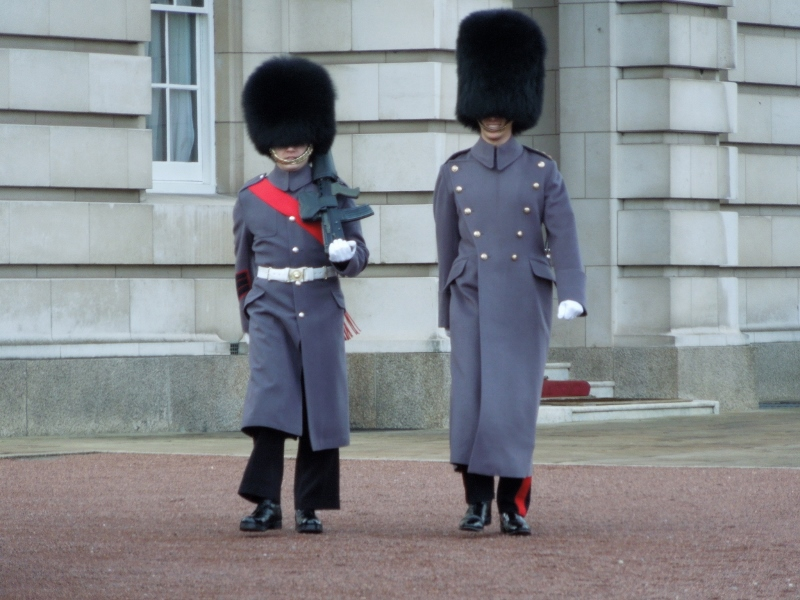 Guards, such as these at Buckingham Palace, also protect the Crown Jewels at the Tower.